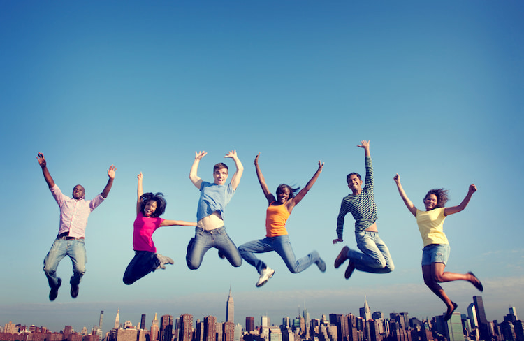 Co-workers Jumping Together in front of New York City skyline