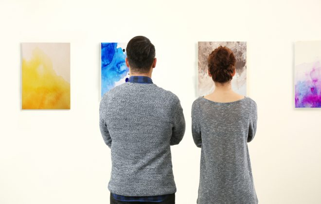 Two people looking at art