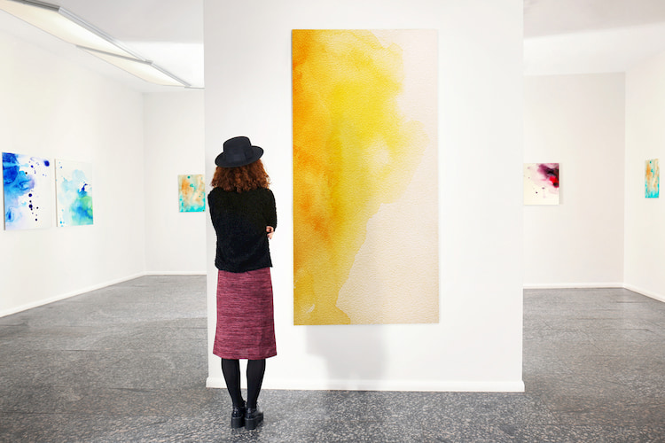 Woman admiring art in a gallery