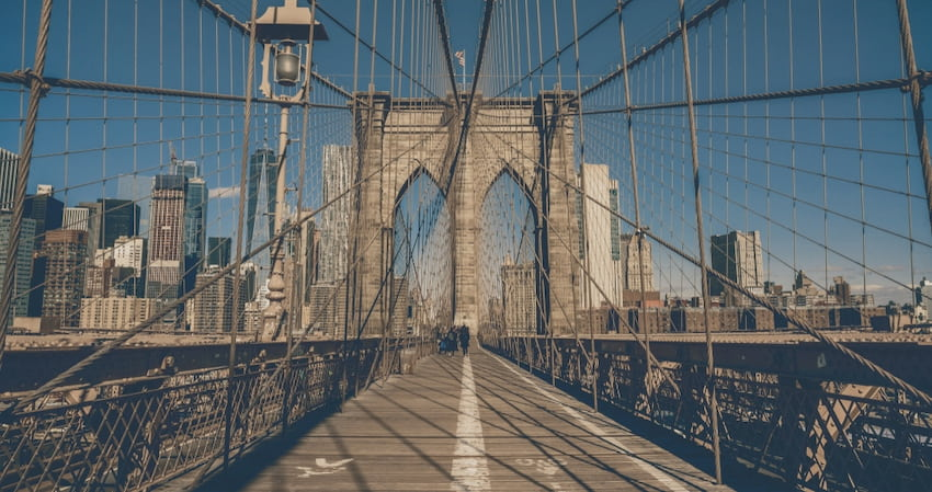 view of the Brooklyn Bridge in New York City from its pedestrian walkway