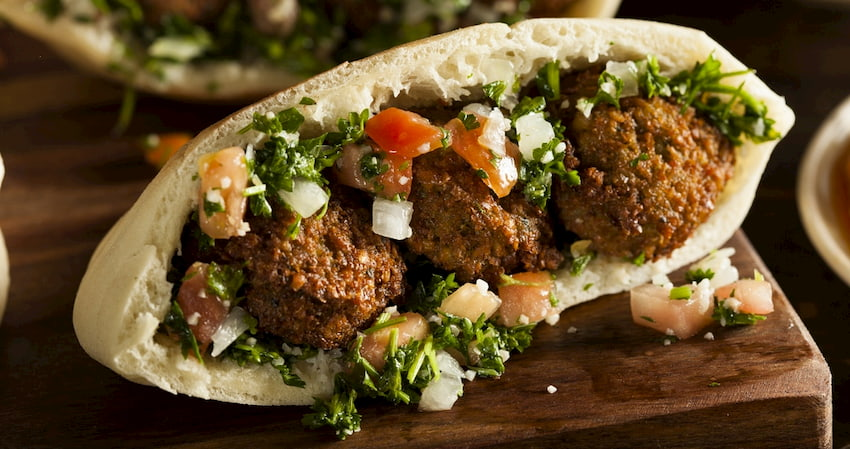 a falafel on a pita from Maumoun's Falafel