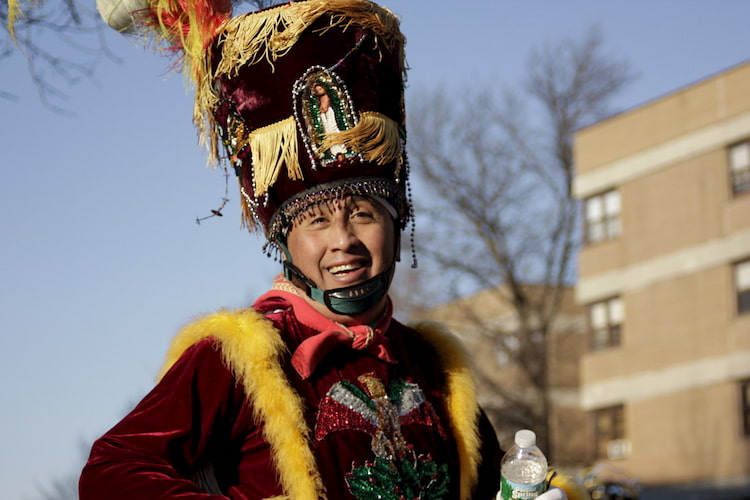 a man smiles while participating in Manhattan's Three Kings Day parade