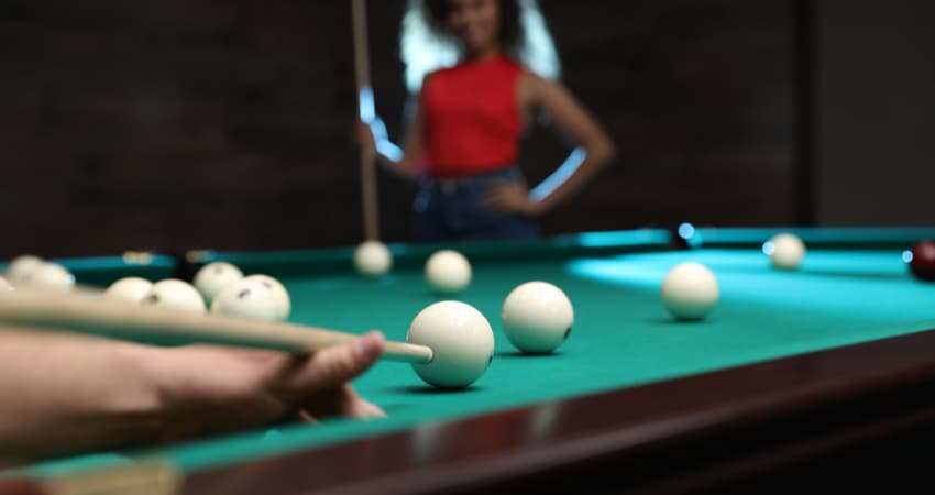 women playing pool at a bar