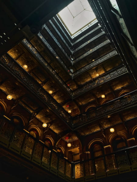 Inside of the Beekman Hotel with view of its skylight.