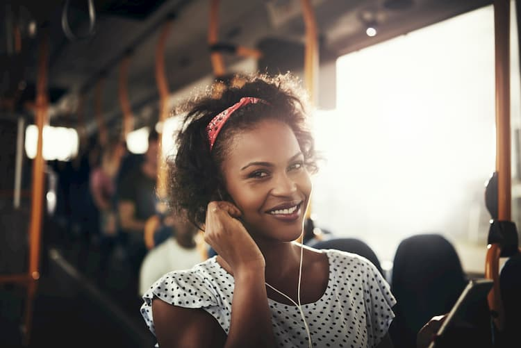 Woman listening to music on bus