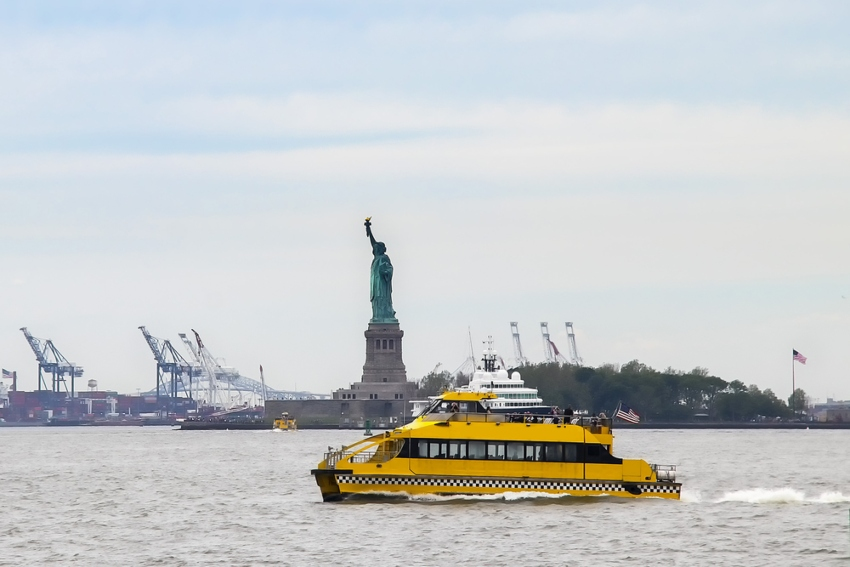 A ferry sails to Liberty Island
