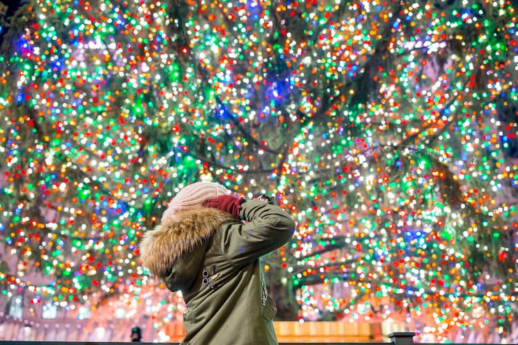 Girl with Rockefeller Christmas tree