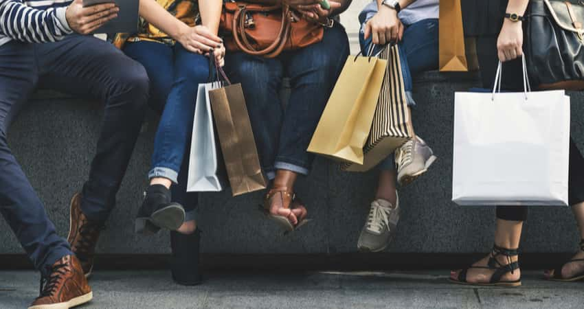 Close up of a group of people holding shopping bags